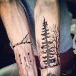 Arrows and pine tree tattoos