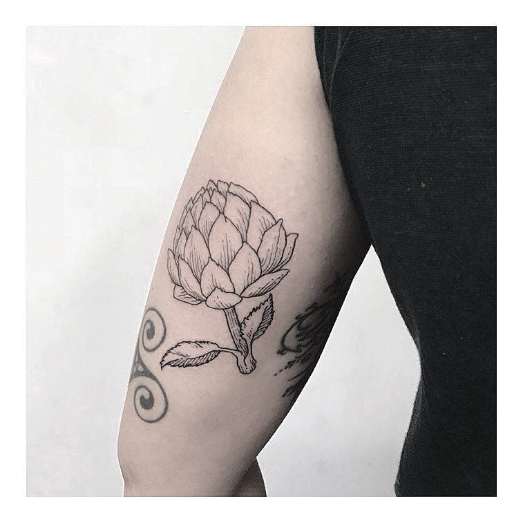 Artichoke head tattoo