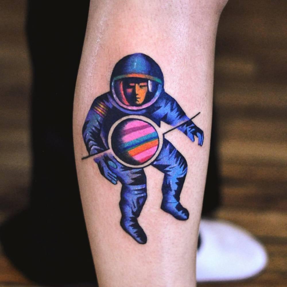 Astronaut and tiny planet by David Côté