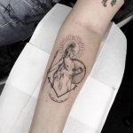 Athena tattoo on the forearm