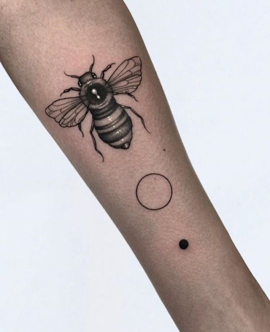 Bee, circle, and dot tattoo