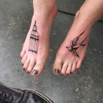 Bird and cage tattoos on feet