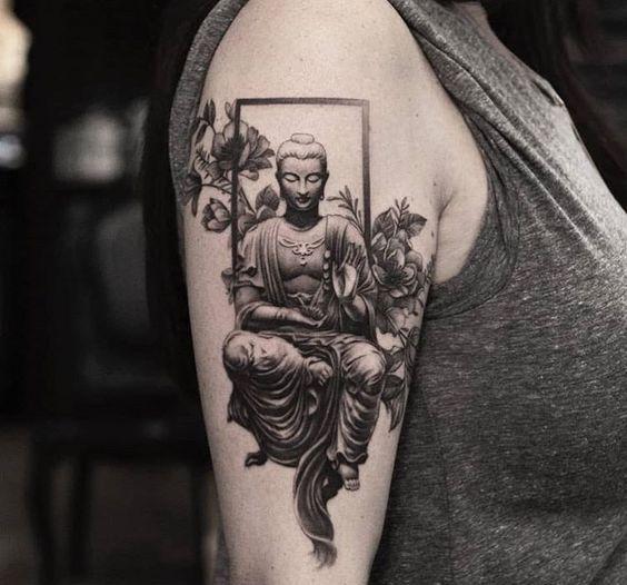 Black and grey Buddha tattoo