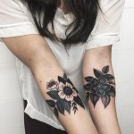 Black and white flowers on forearm