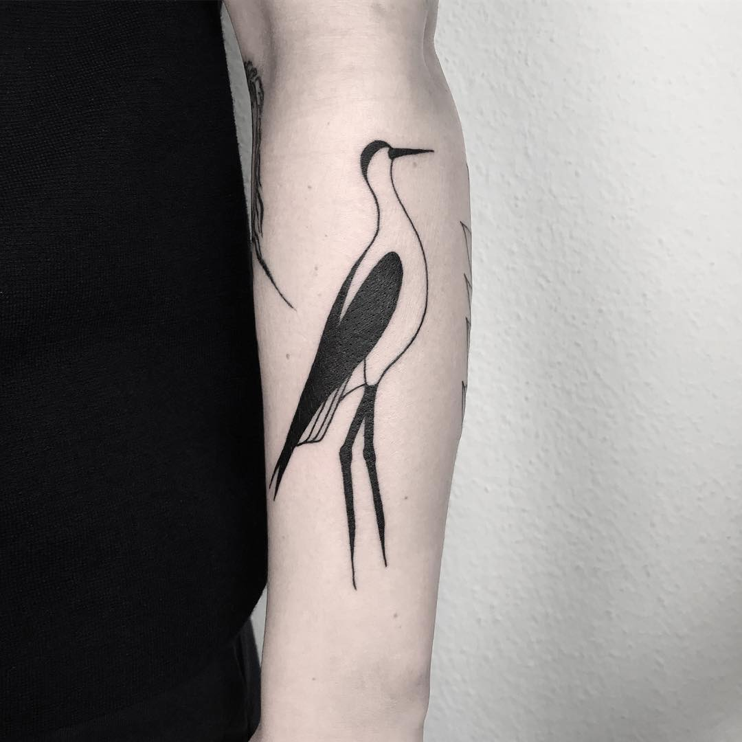 Black and white stork tattoo