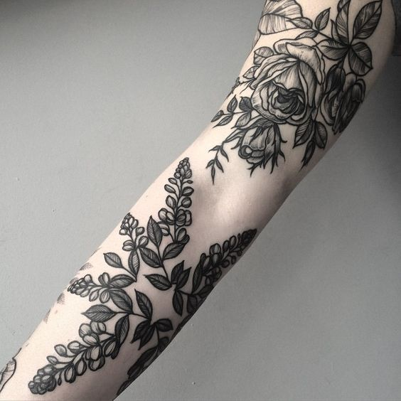 Black floral pieces on the arm