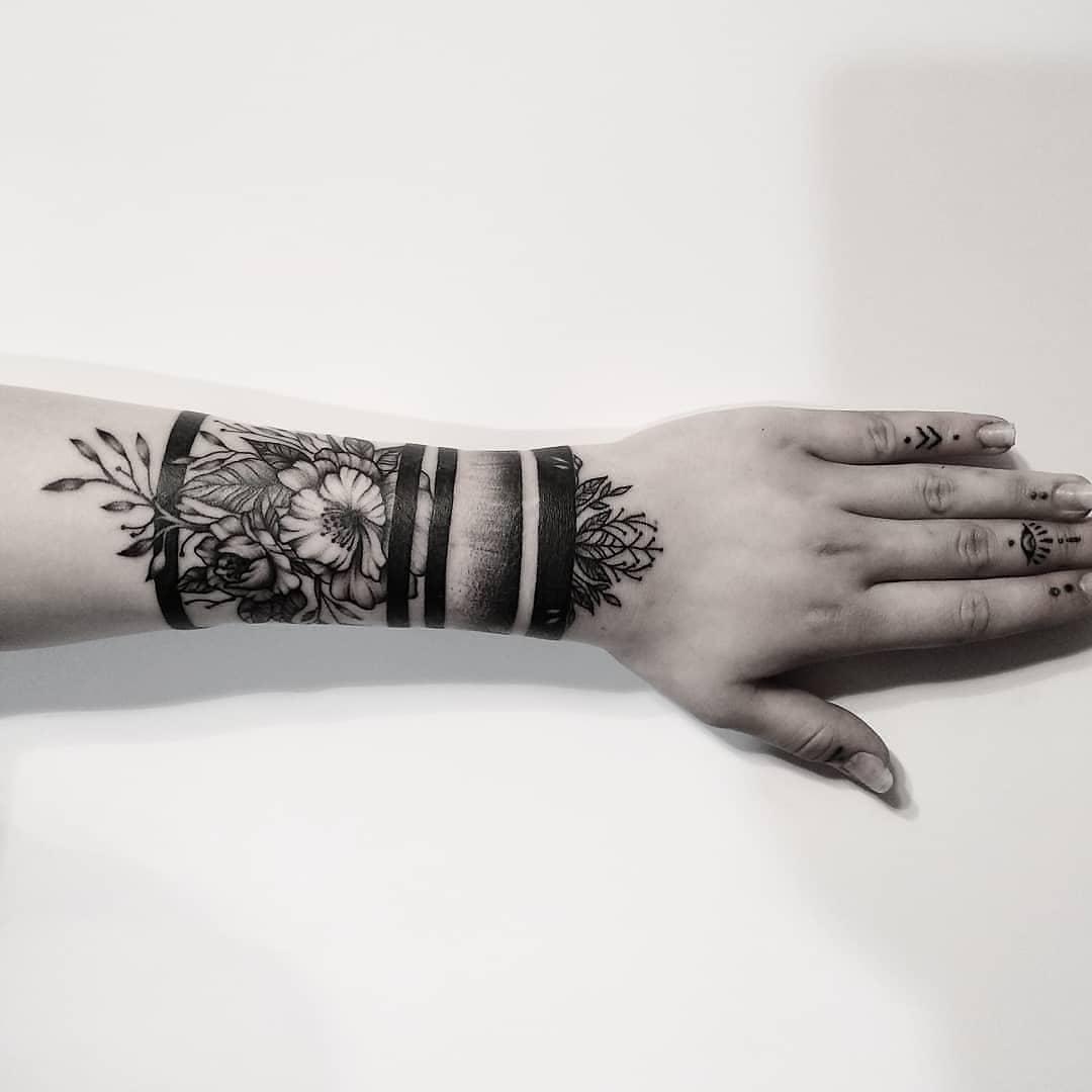 Blackwork floral armband tattoo