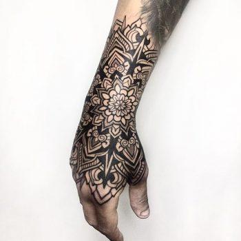 Blackwork mandala tattoo by Melow Perez