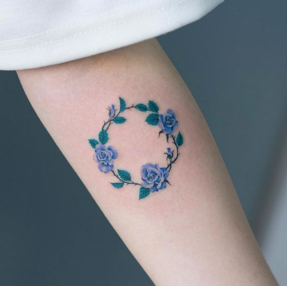 Blue roses circle tattoo