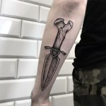 Bone dagger tattoo