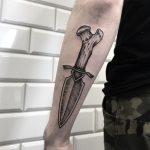Bone dagger tattoo
