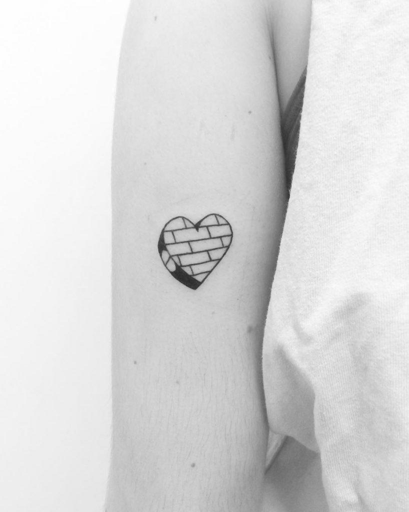 Brick wall heart tattoo