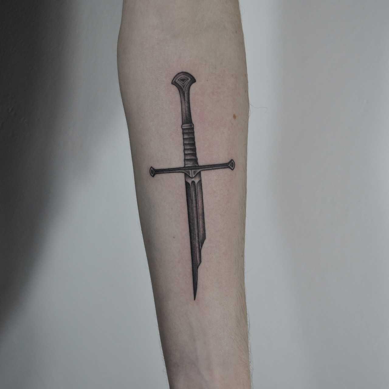 Broken sword tattoo by Berkin Donmez