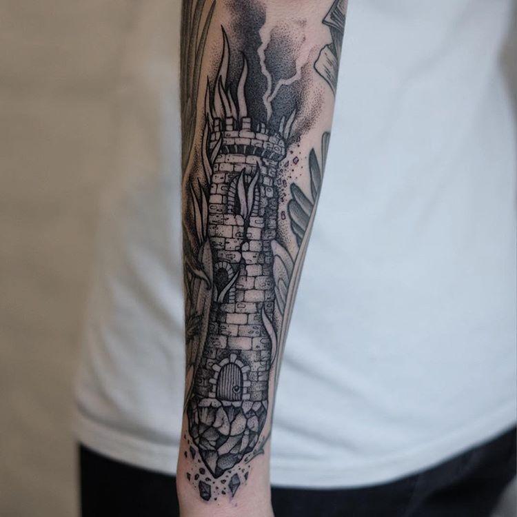 Burning tower tattoo by Sasha Tattooing