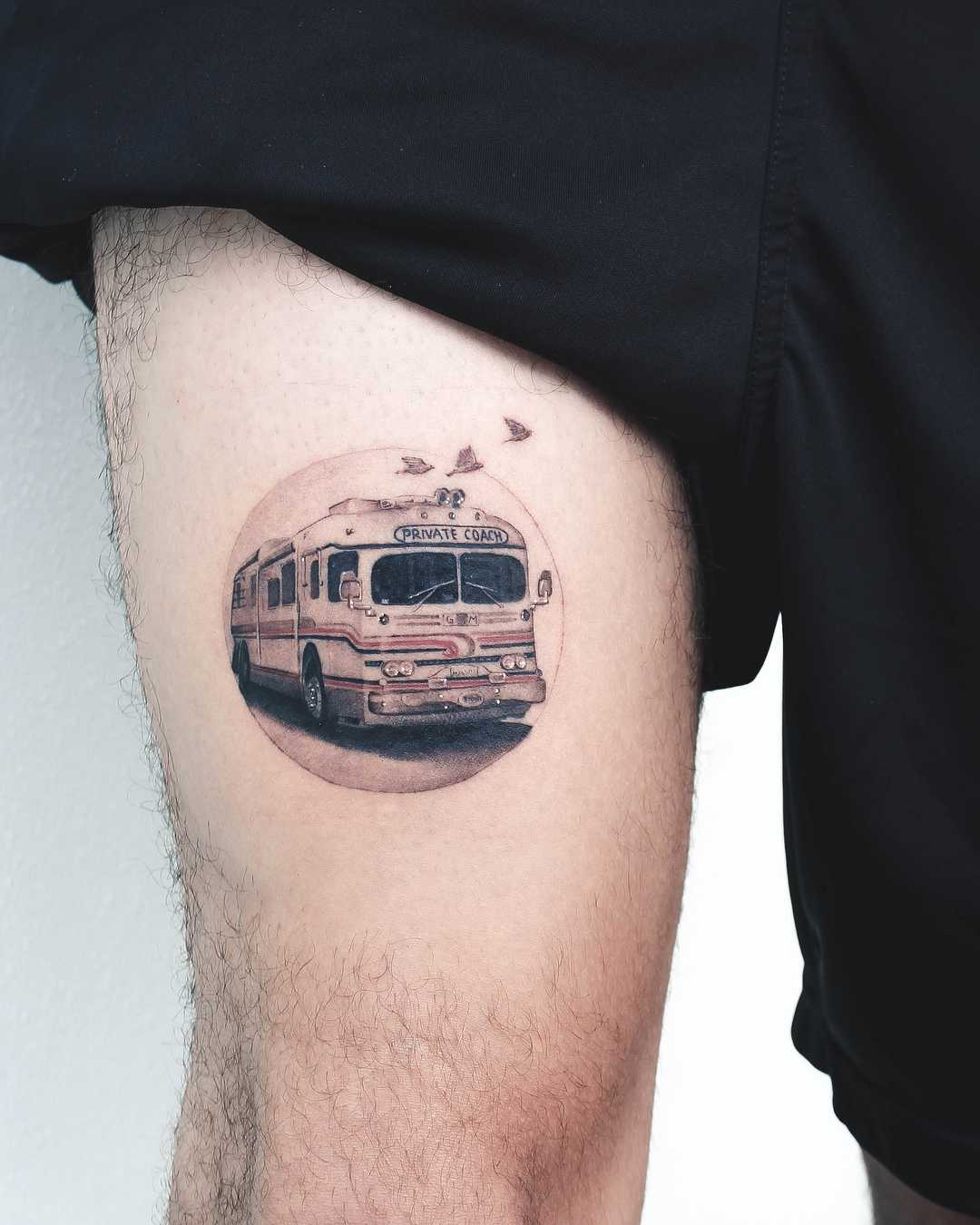 Bus tattoo on the thigh
