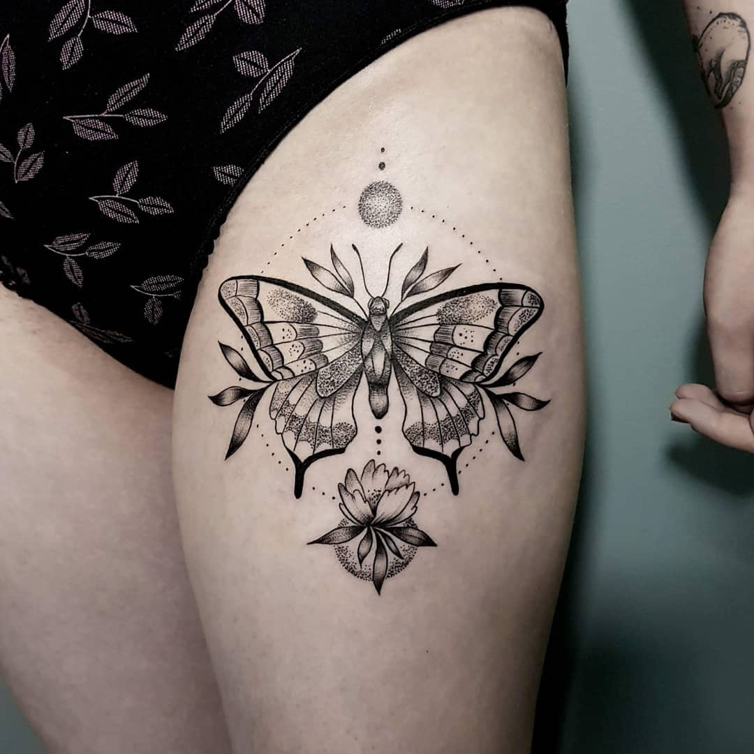 Butterfly and flower tattoo on the thigh