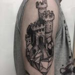 Castle on a rock tattoo