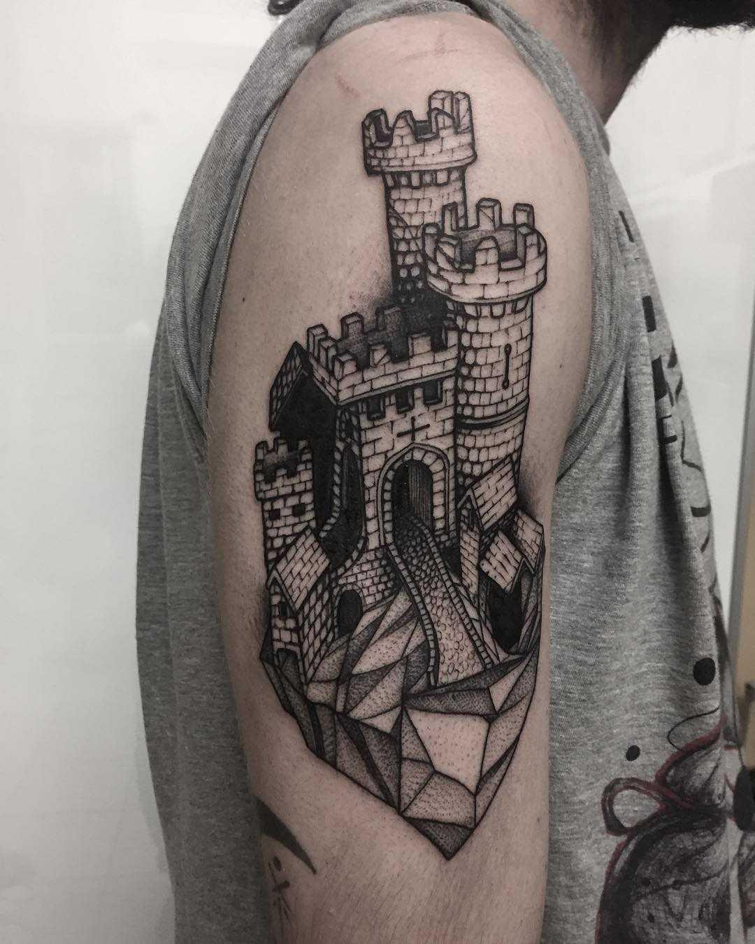 Castle on a rock tattoo
