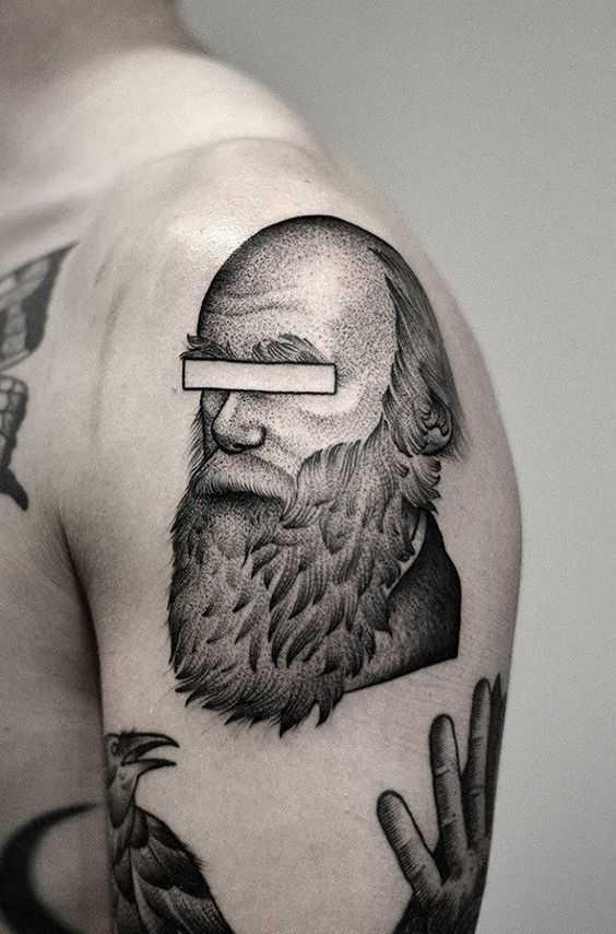 Censored face tattoo