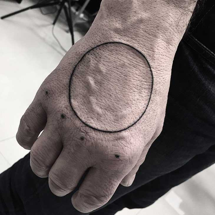 Circle and five dots tattoo by Jay Lester