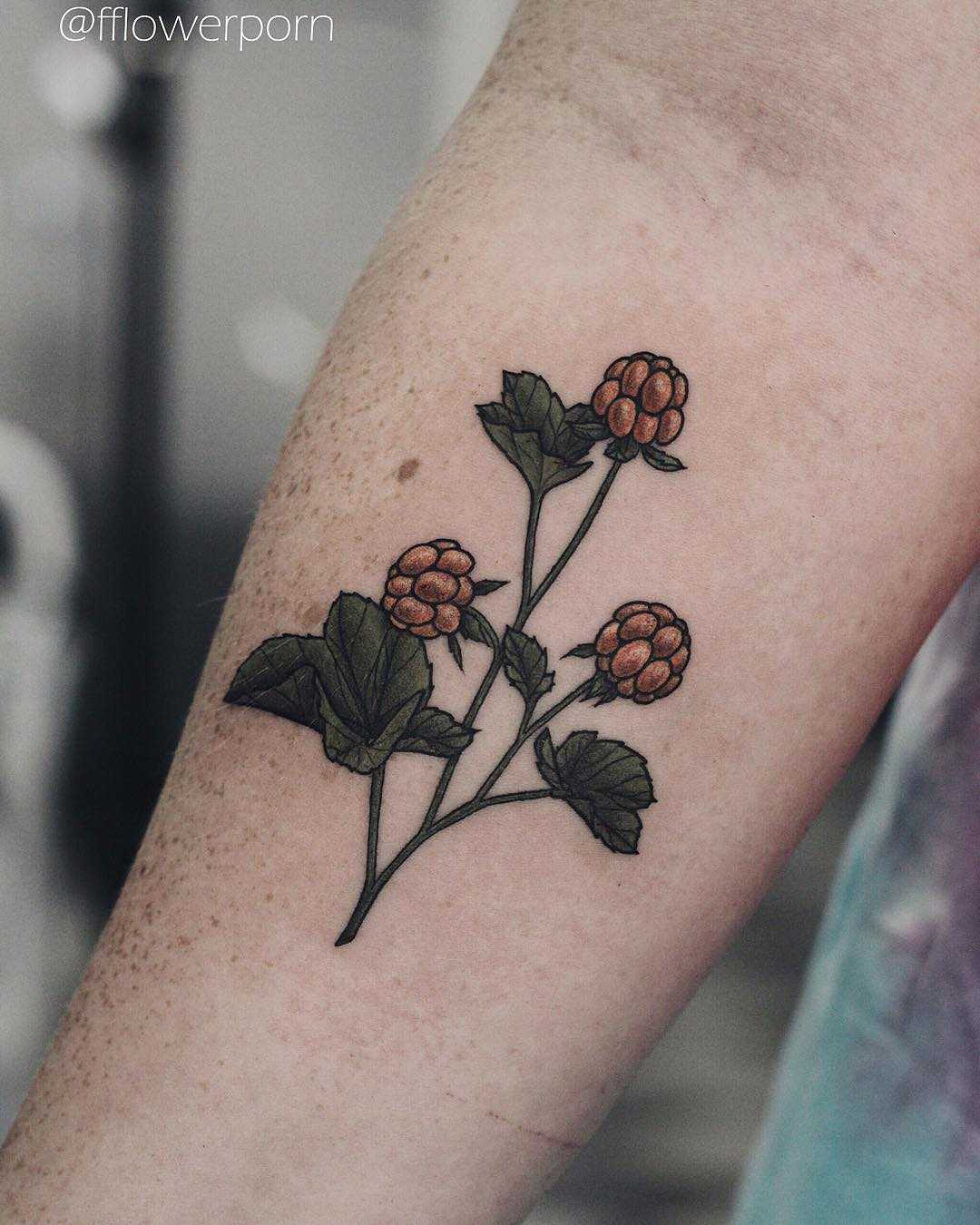 Cloudberry tattoo on the forearm