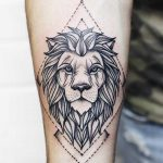 Crisp lion tattoo