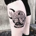 Crystal ball with Hogwarts scenery tattoo
