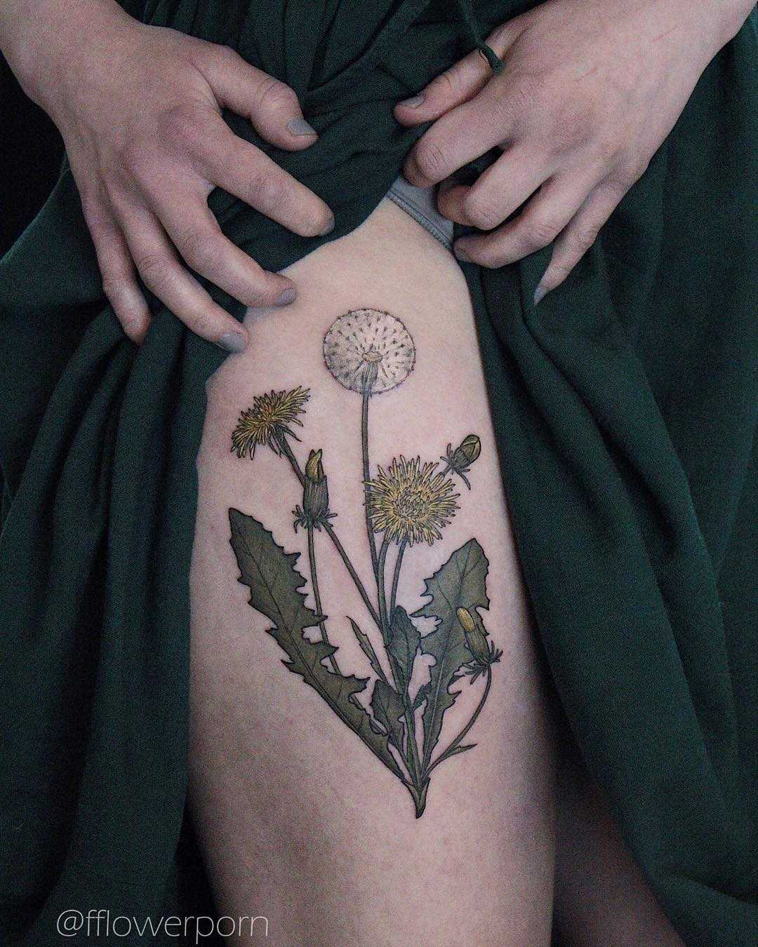 Dandelions tattoo on the thigh