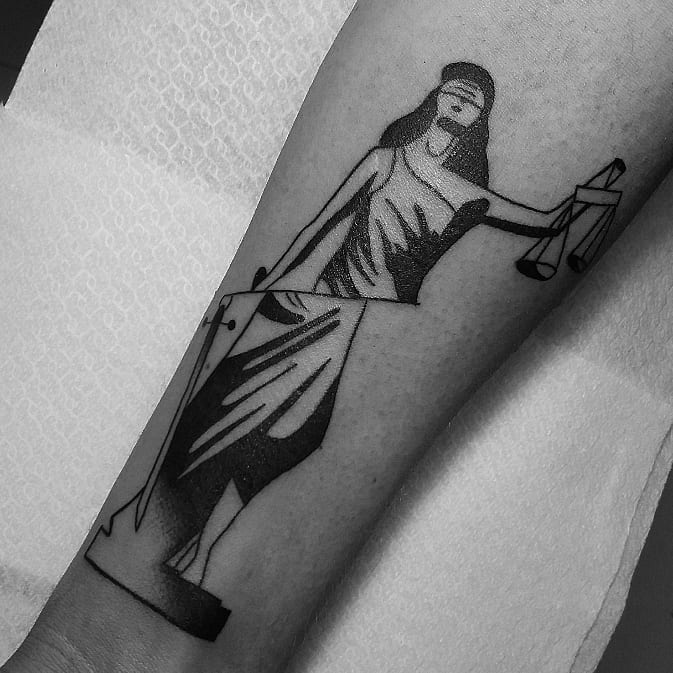 Deconstructed Lady Justice tattoo by Jay Lester