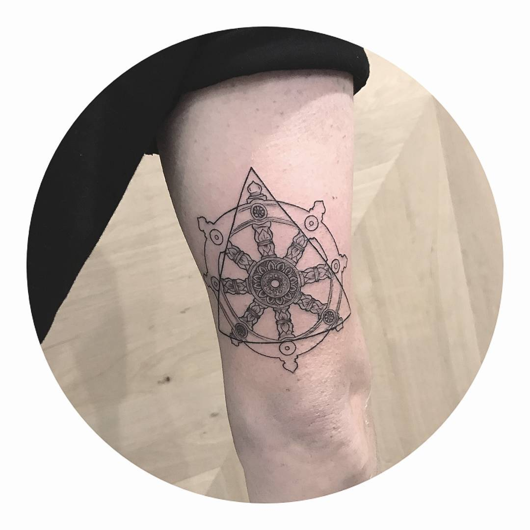 Dharma Wheel tattoo by Cholo