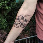Double exposure skull and beach tattoo