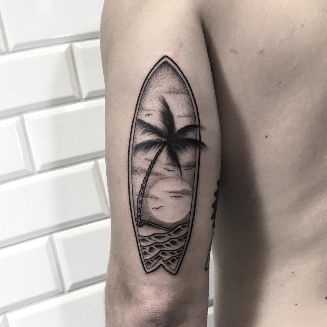 Double exposure surfboard and landscape tattoo done at Kult Tattoo Fest