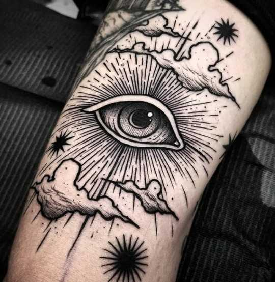 Eye in the clouds tattoo