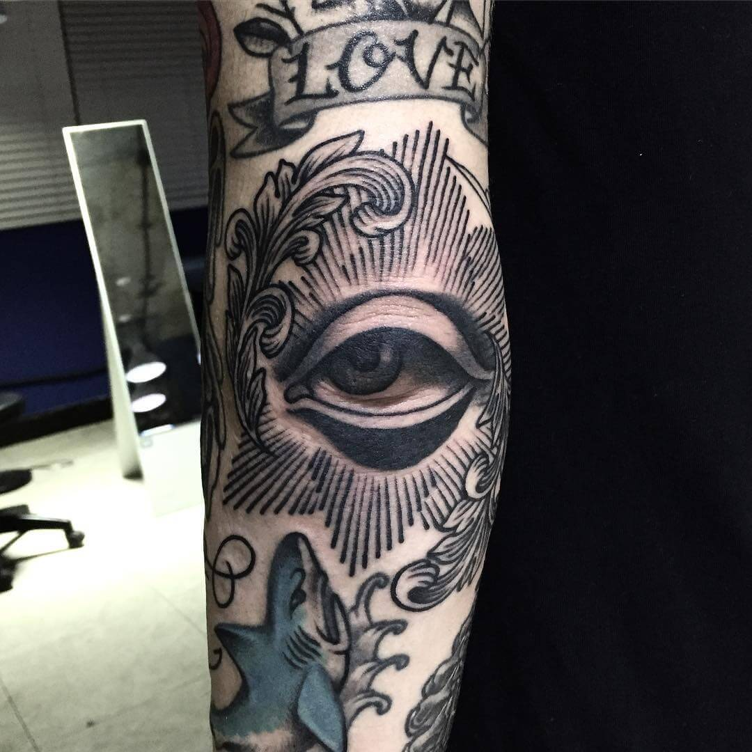 Eye tattoo on the elbow