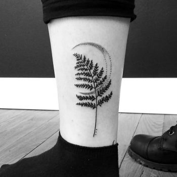 Fern leaf and crescent moon tattoo