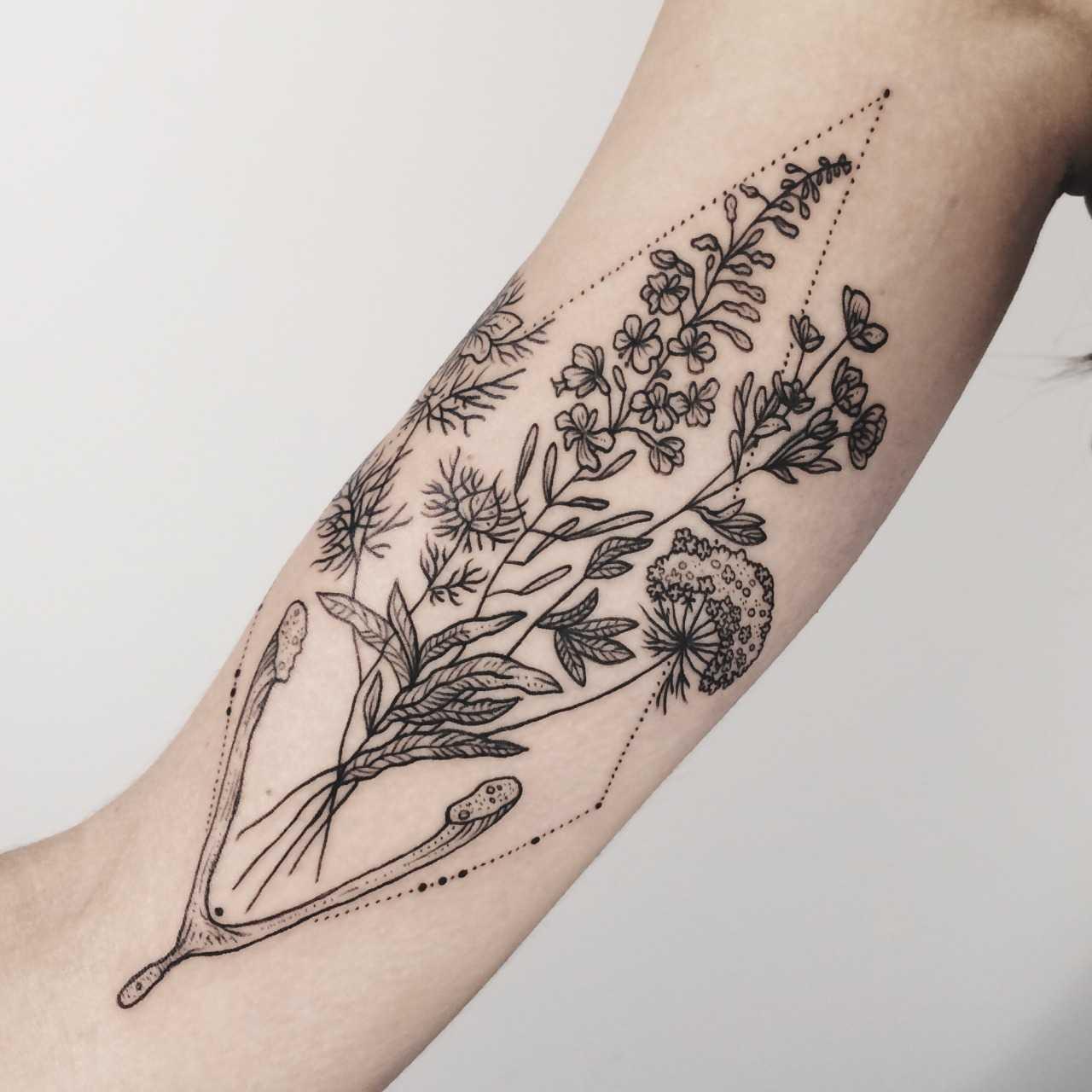Flora of Alaska and wishbone tattoo by Pony Reinhardt