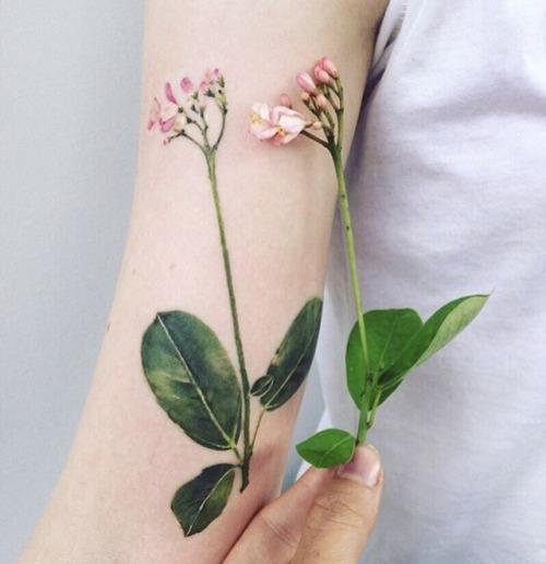 Flower tattoo by Pissaro