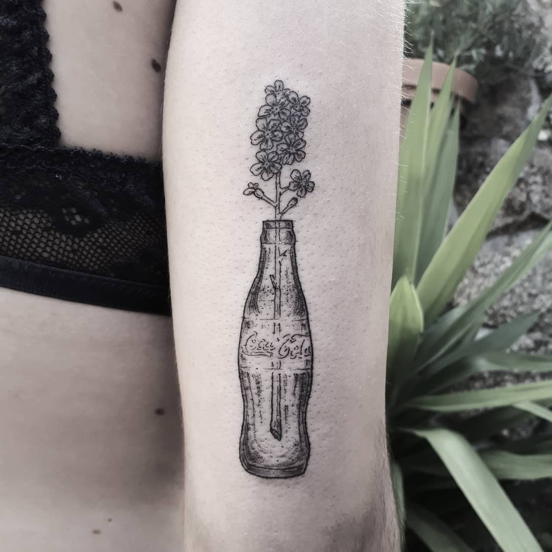 Flowers in a Coca-Cola bottle