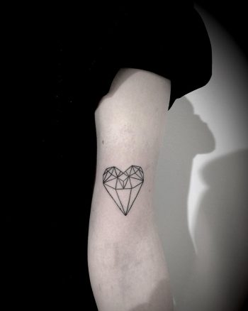 Geometric heart-diamond tattoo