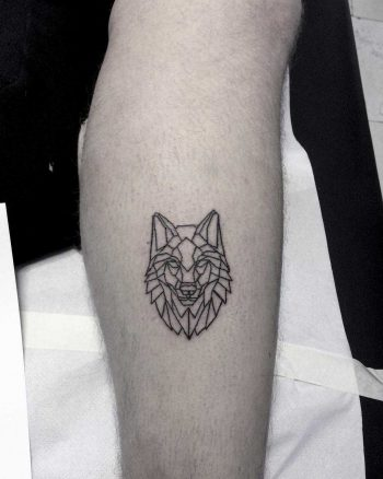 Geometric wolf head tattoo