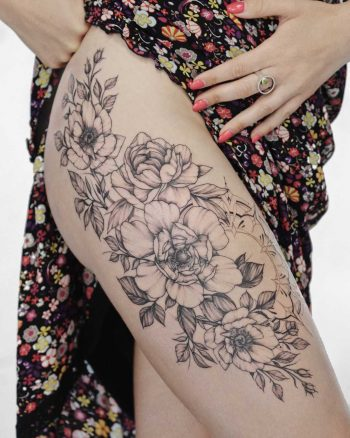 Gorgeous floral tattoo on the thigh