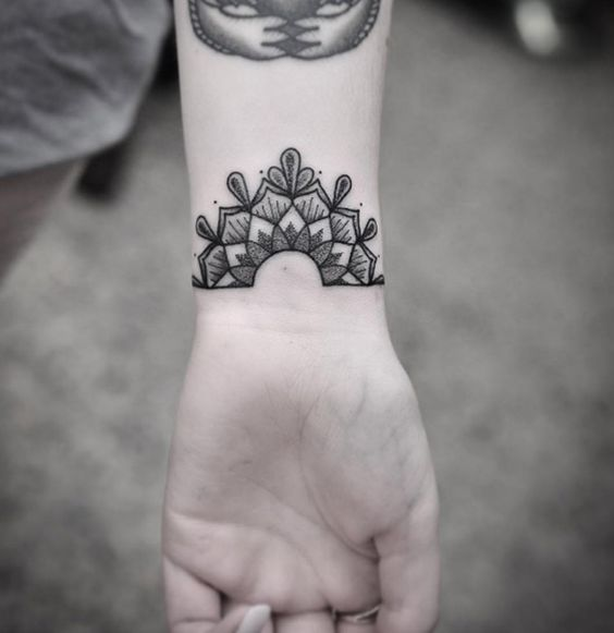 Gorgeous half mandala tattoo