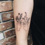 Hands with flowers tattoo