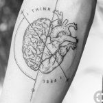 Heart and brain tattoo on the forearm
