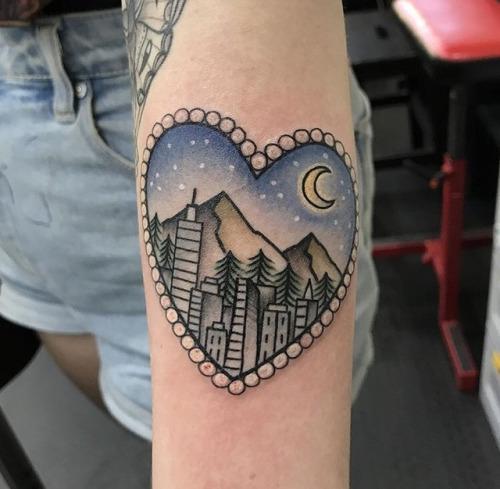 Heart-shaped city scenery tattoo