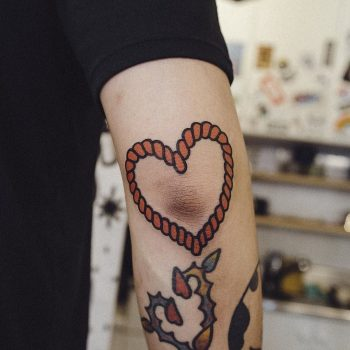 Heart tattoo by Woo Tattooer