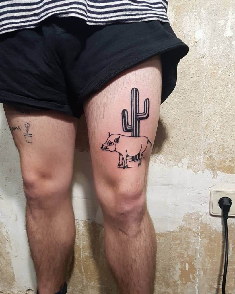 Hog and cactus tattoo on the thigh