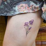 Iris flowers tattoo on the thigh