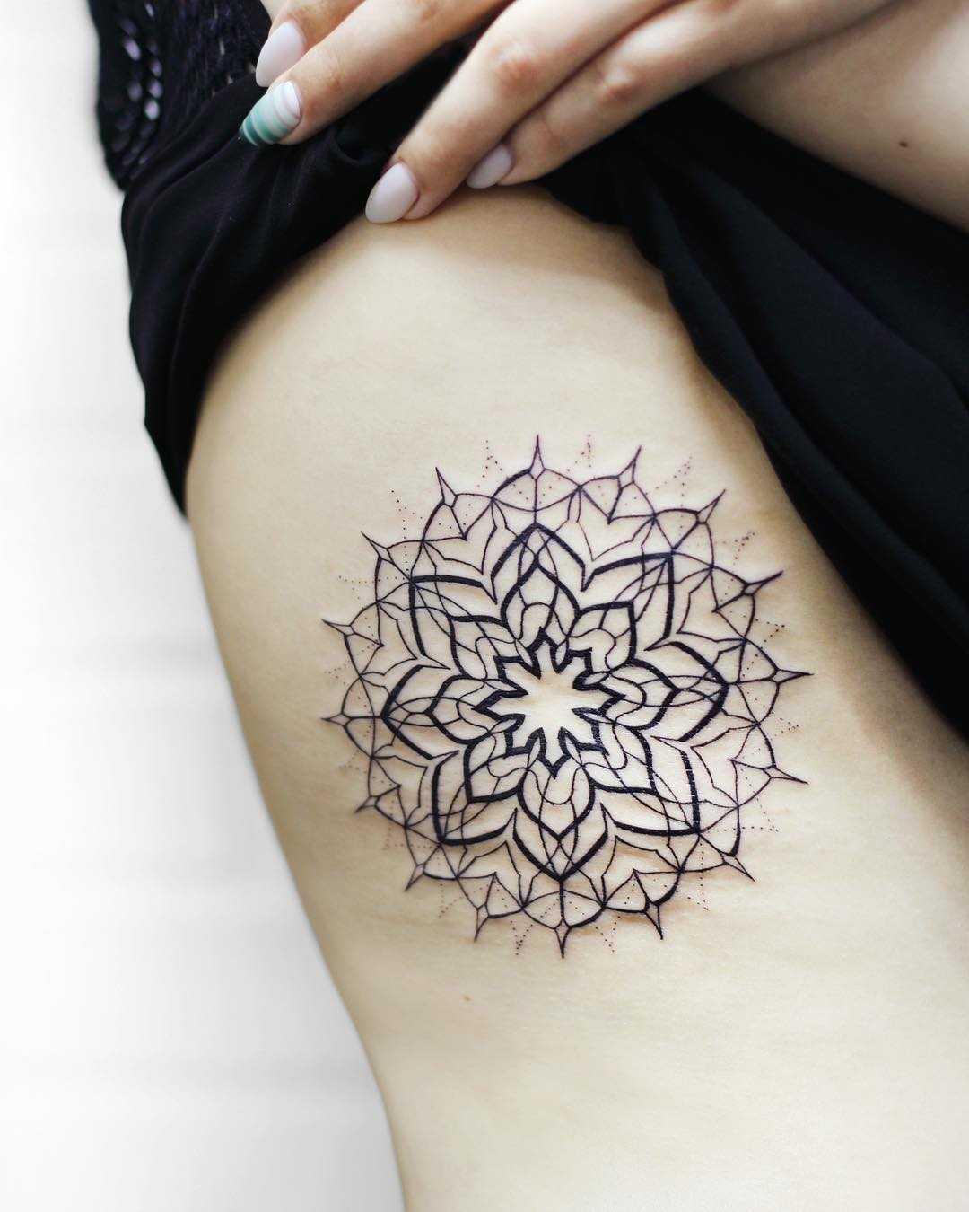 Lacy mandala tattoo