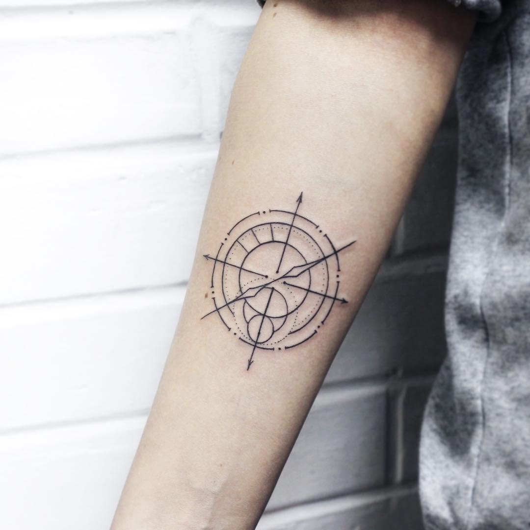 Linear minimalist compass tattoo